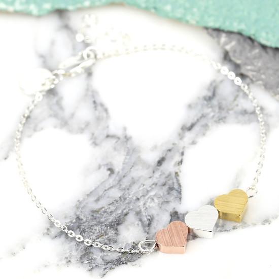 brushed-mixed-metal-triple-heart-bracelet-O21A5998.-550×550